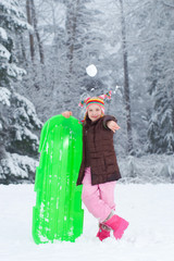 Young girl throwing a snowball