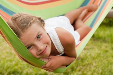 Lovely girl in colorful hammock