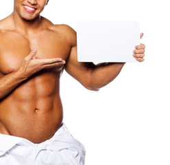 Image of sexy male holding blank sign