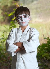 The boy with a samurai makeup