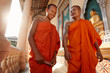 Leinwanddruck Bild - Two monks meet and salute in a buddhist monastery, Asia