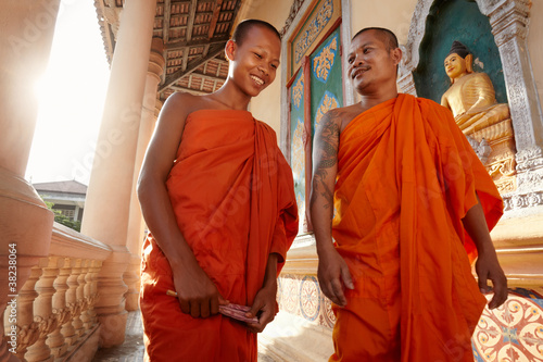 Two monks meet and salute in a buddhist monastery, Asia