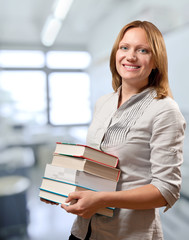 teacher or student holds the books
