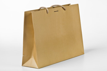 Beige shopping bag.