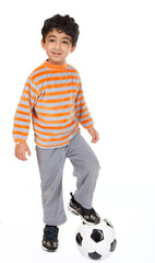 Handsome Young Boy Stands with Foot on Football, On White Backgr