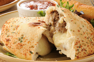 Steak and cheese calzone