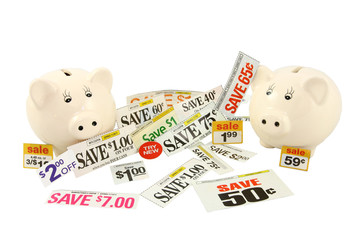 Two Piggy Banks With Money Saving Coupons And Deals