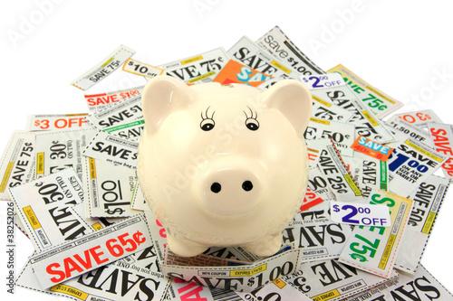 Keuken foto achterwand Boodschappen Piggy Bank Standing On Grocery Coupons