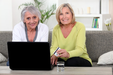Older women using a credit card online