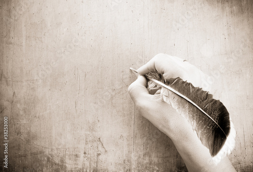 writing hand and pen on wood