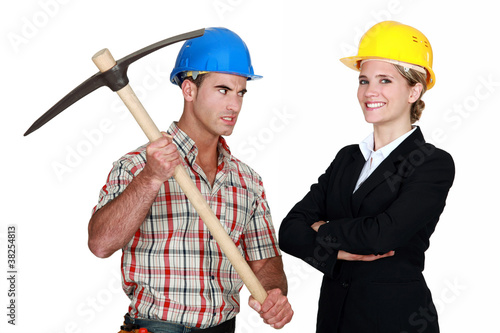 Builder aiming his pickaxe at a smiling architect
