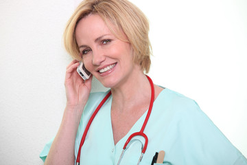Female nurse speaking on mobile telephone