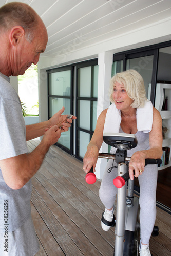 Man timing his wife's workout