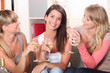 three girlfriends drinking wine together