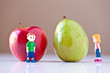 Girl and Boy Overshelmed by Healthy Food Choices (Pear and Apple