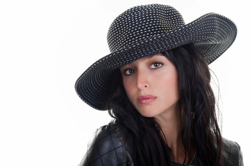 Beautiful young woman with a black and white hat