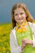 Yellow meadow - portrait of girl with dandelion