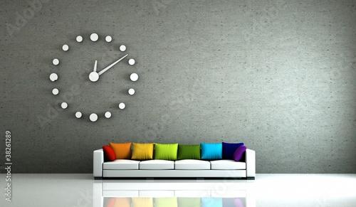 Wohndesign - Sfa mit bunten Kissen und Uhr