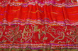 Closeup of red eastern scarf interwoven ornament
