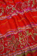 red scarf with white interwoven ornament