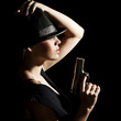 The young woman in a hat and with a pistol