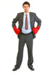 Serious modern businessman in boxing gloves