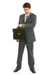 Full length portrait of modern businessman with suitcase