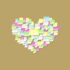 Post it notes heart on cork board