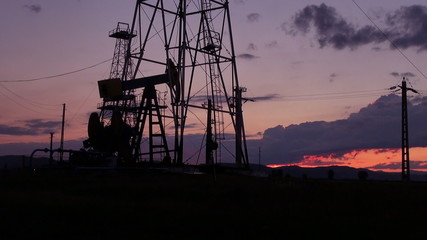 oil pumps silhouetted