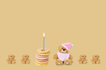 teddy bears and birthday biscuits on the brown background
