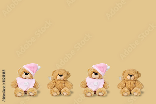 Teddy bears on the brown background