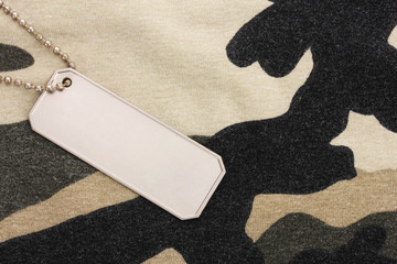 Army badges on camouflage background