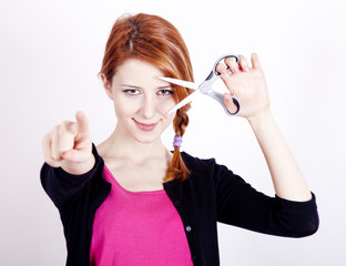 Redhead girl with scissors.