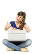 Happy woman with laptop showing thumbs up