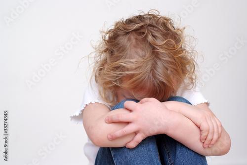 Leinwanddruck Bild trauriges Mädchen