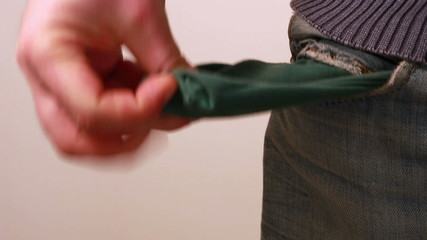 Man showing his empty pocket