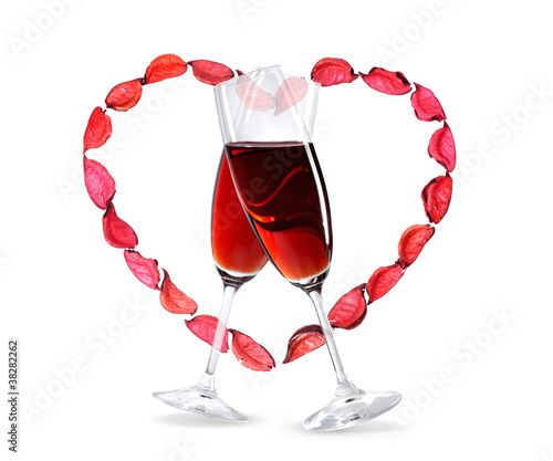 Wineglasses with red wine inside a heart shape