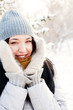 Portrait of young beautiful girl outdoors in winter having fun a