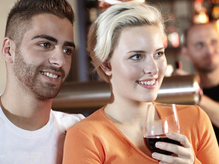 Pretty young couple sitting in a pub