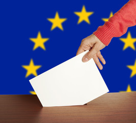 Hand with ballot and box isolated on Flag of Europe