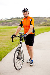 senior man standing by his road bicycle