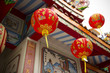 three Red Chinese lantern hanging on temple roof.