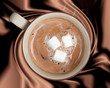 Hot Chocolate Wrapped in Rich Dark Brown Silky Background