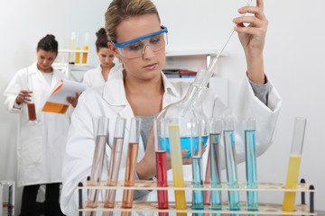 Three women in science laboratory