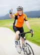 happy senior male bicyclist giving thumb up