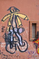 Graffiti paintings on wall. Dirty city wall