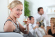 Woman drinking champagne at a party