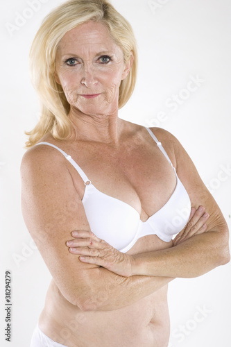 Portrait of semi nude mature woman with arms crossed. Ajouter au Panier