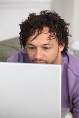 Metis man using laptop at home