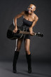 Happy African American woman playing guitar